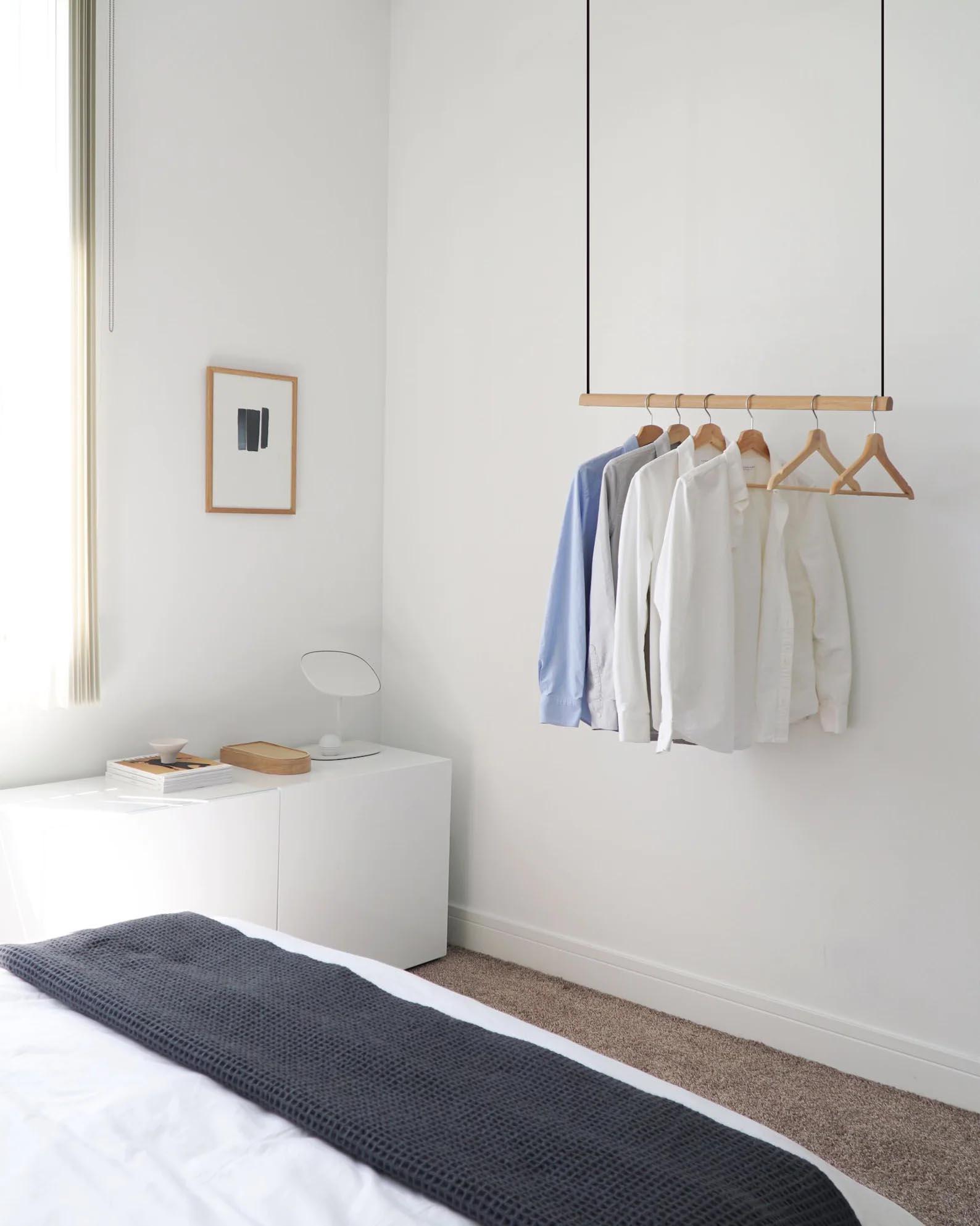 Storage Idea - Modern hanging wood clothes rack.