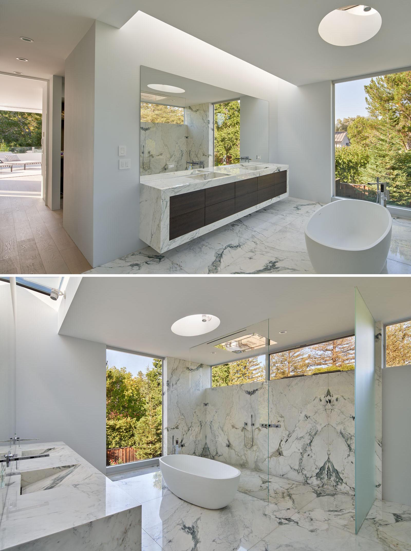 In the master bathroom, there's a double vanity, a freestanding bathtub, and a large walk-in shower.