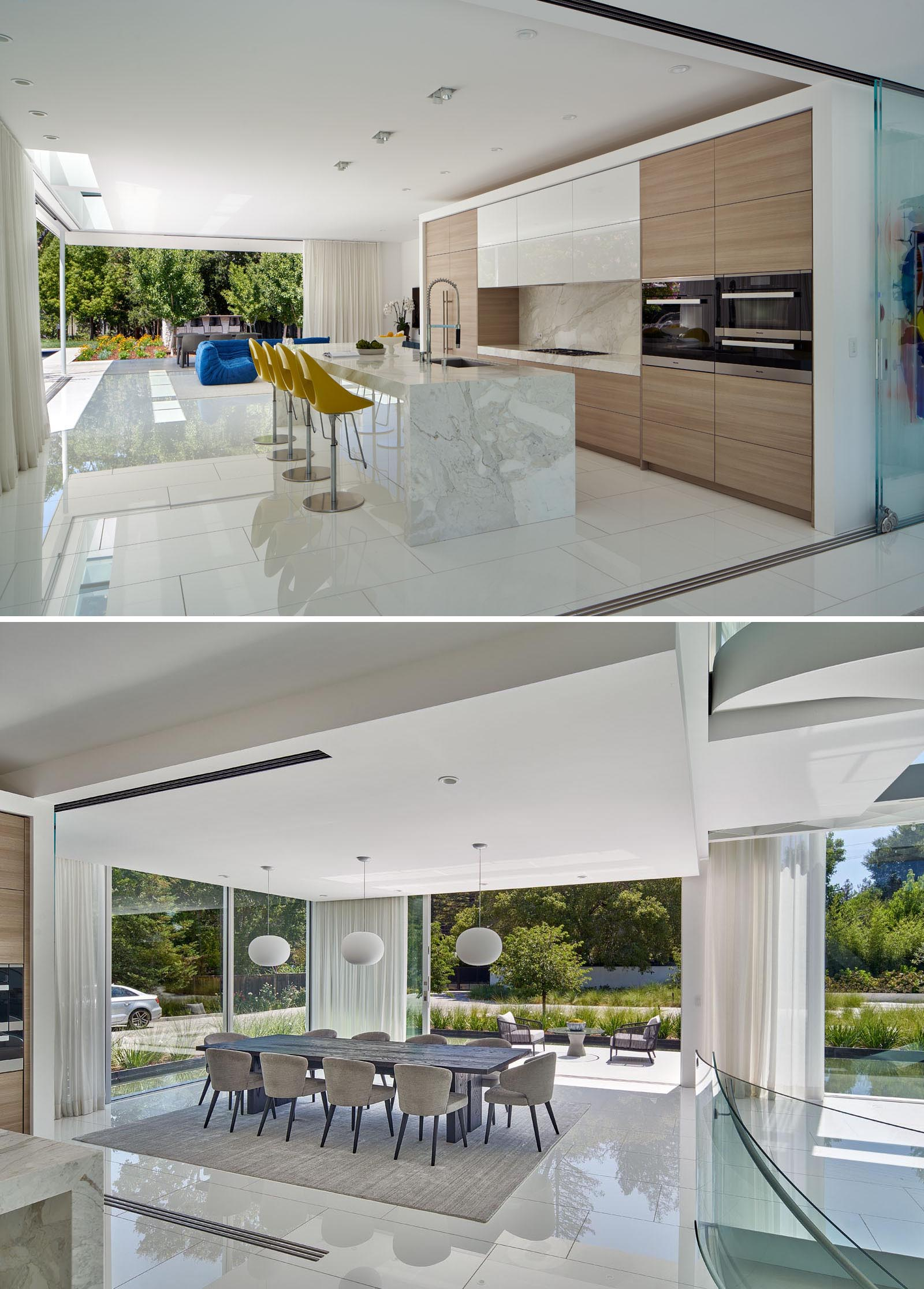 The kitchen and dining room are located next to each other, with kitchen featuring hardware free wood cabinets and Calacatta Marble slab countertops.