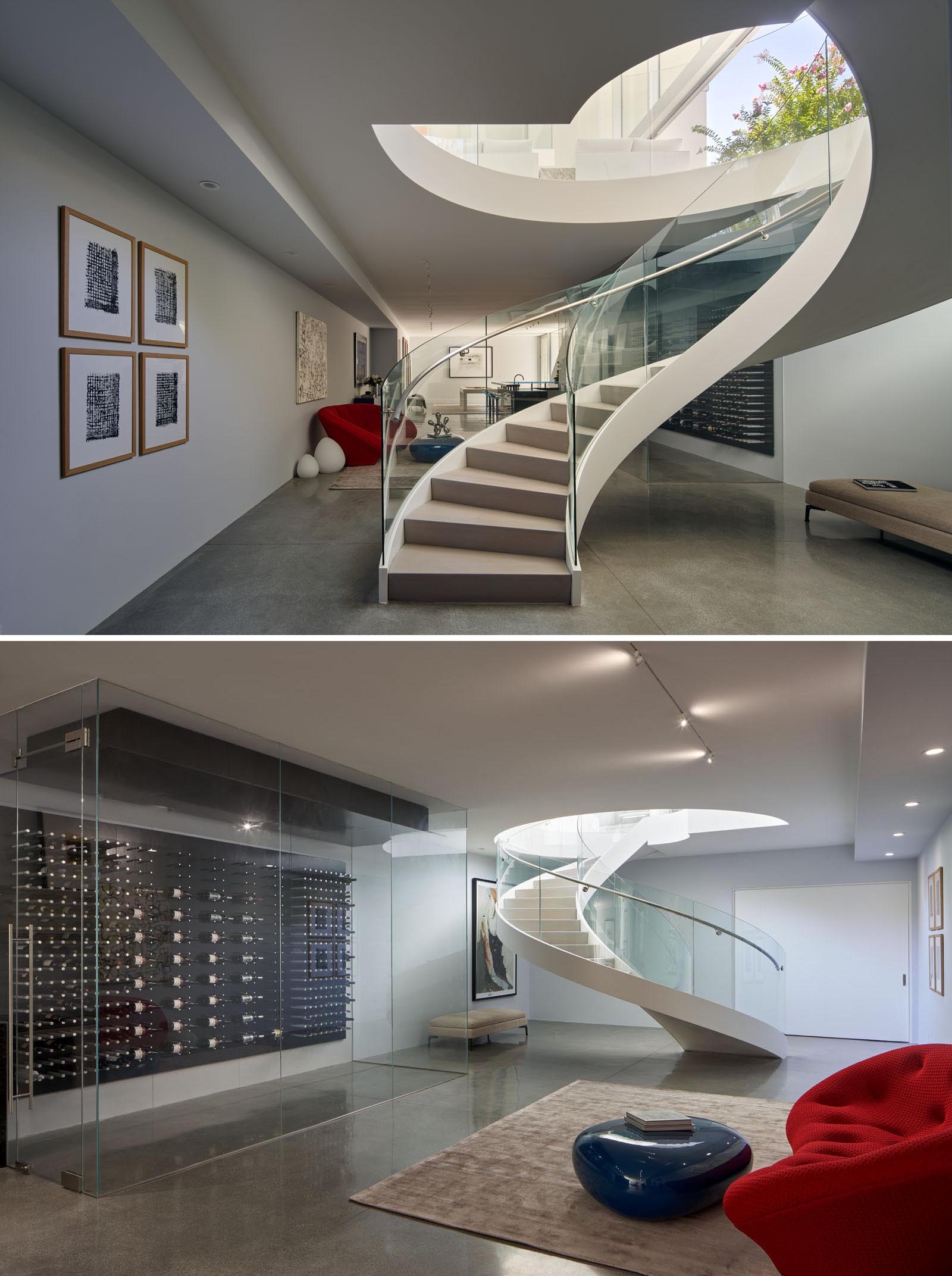 At the bottom of these spiral stairs is the basement that features concrete flooring, a casual lounge, and a wine storage wall.