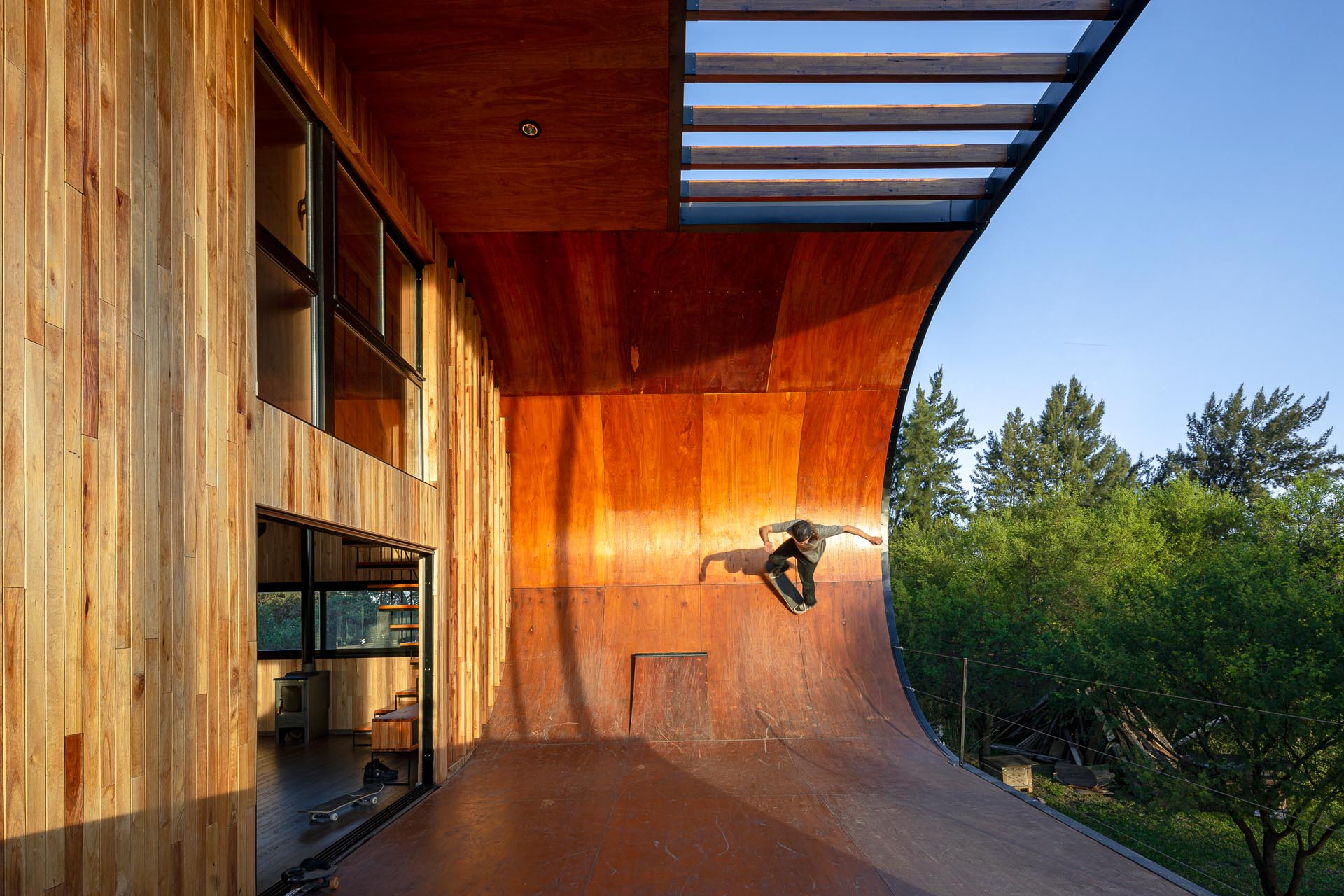 A small and modern house with a built-in skateboard ramp.