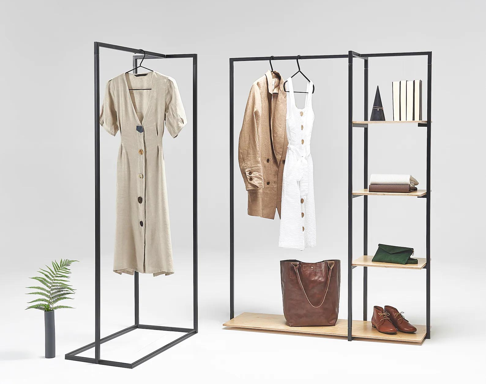 Storage Idea - Modern freestanding black and wood clothes rack.