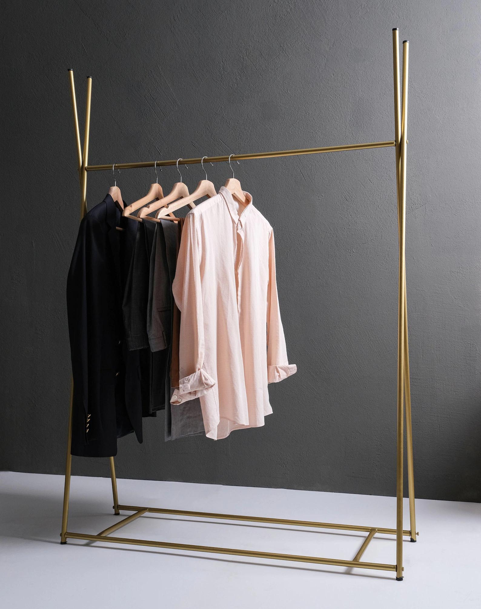 Storage Idea - Modern freestanding gold clothes rack.