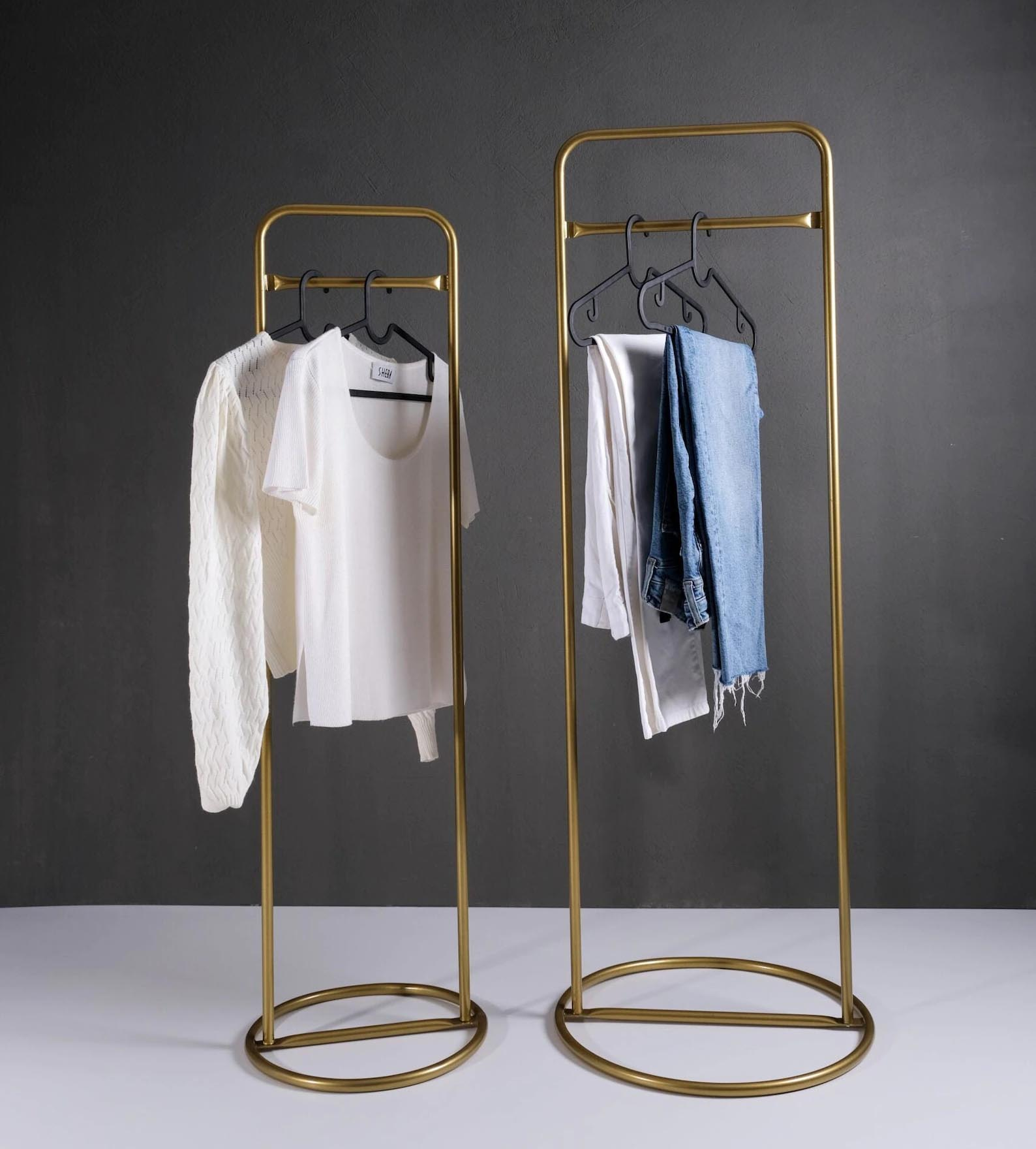 Storage Idea - Modern freestanding gold clothes rack with round base.