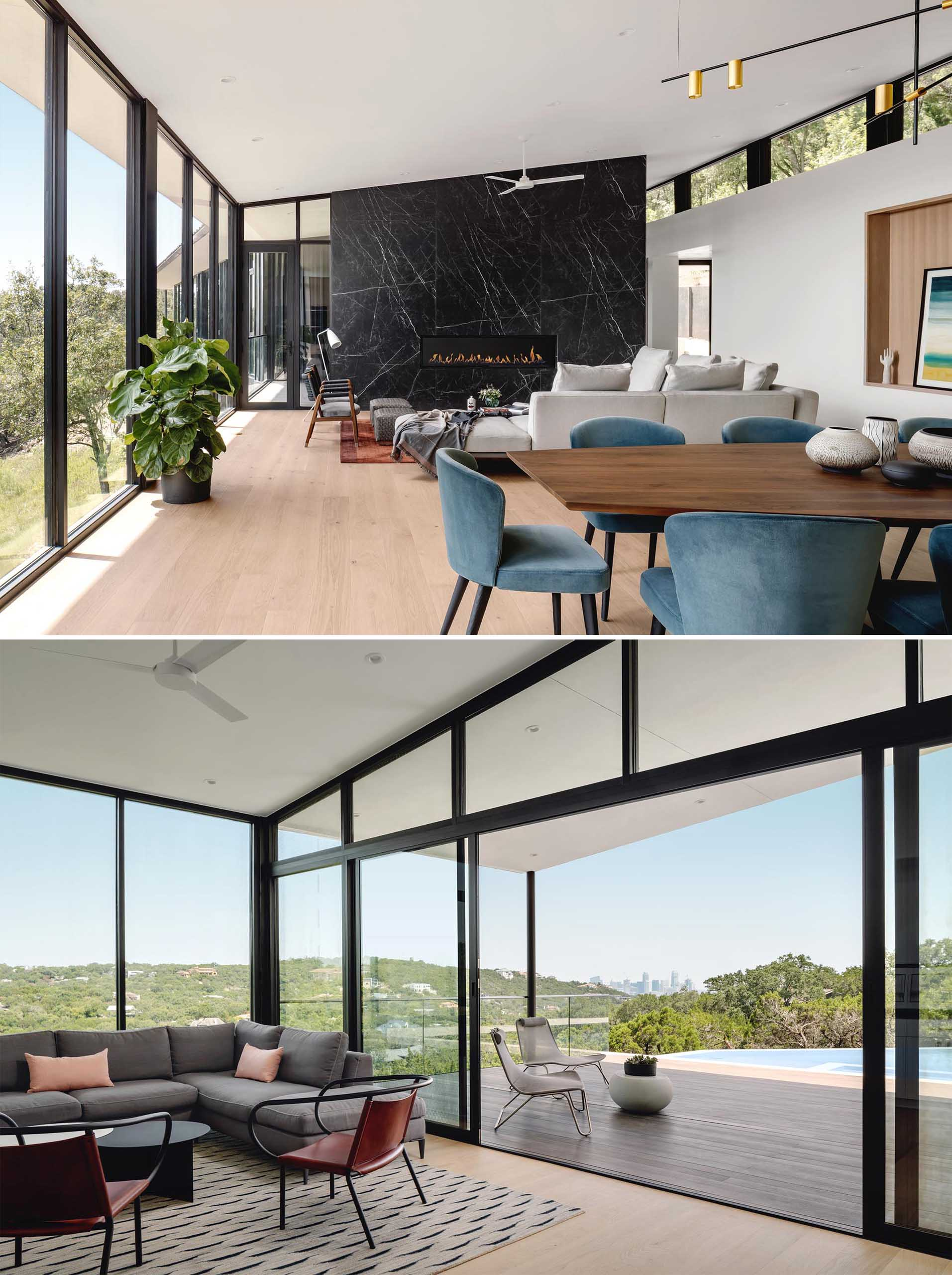 Inside this modern home, the living areas are open plan with the main living room, dining area, and kitchen all sharing the space, while a secondary living space is located by the pool and opens to a covered patio.