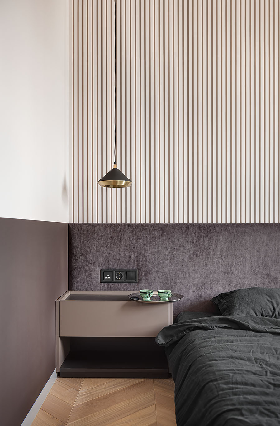 A two-tone bedroom includes different shades of chocolate and beige.