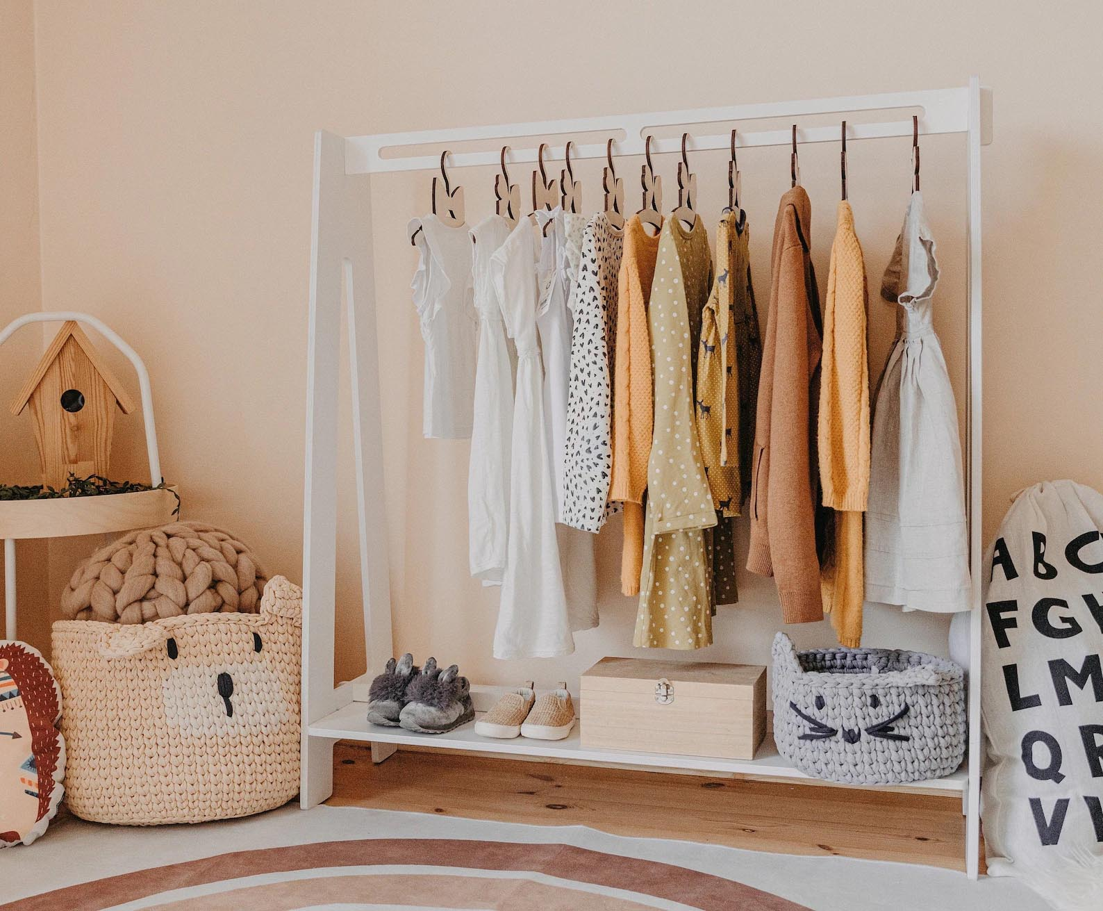 Storage Idea - Modern kid's white freestanding clothes rack.