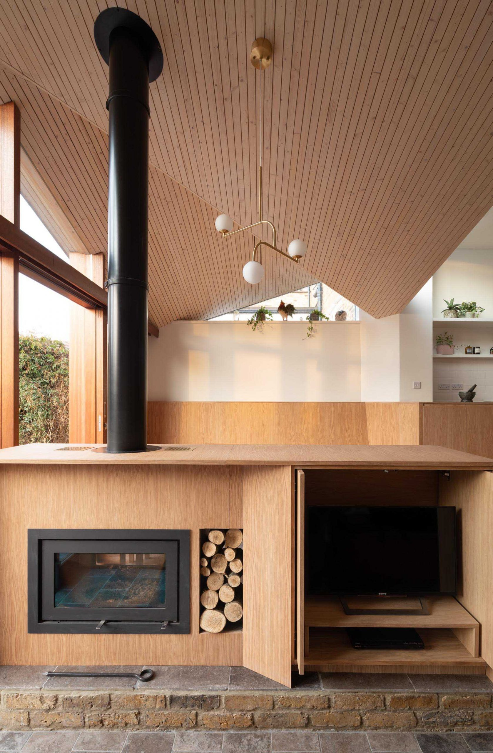 A modern interior with a fireplace and TV hidden within a cabinet.