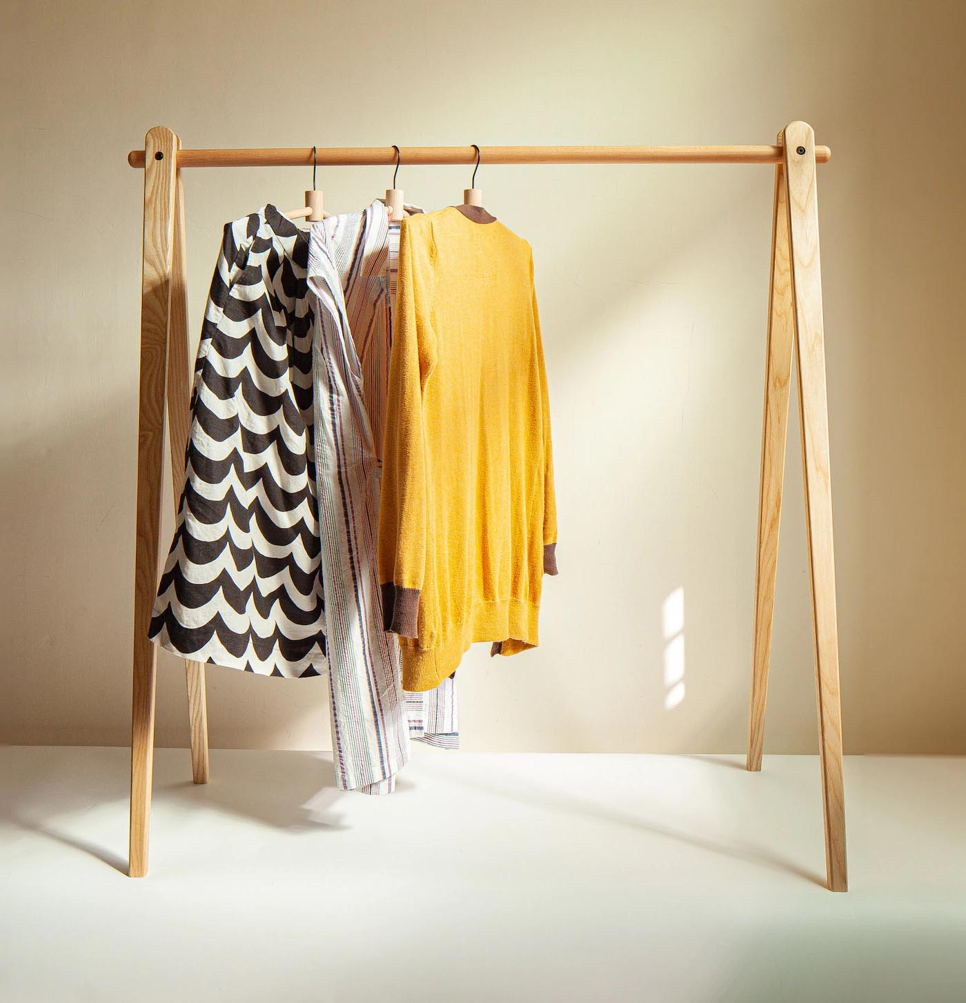 Storage Idea - Modern freestanding wood clothes rack.