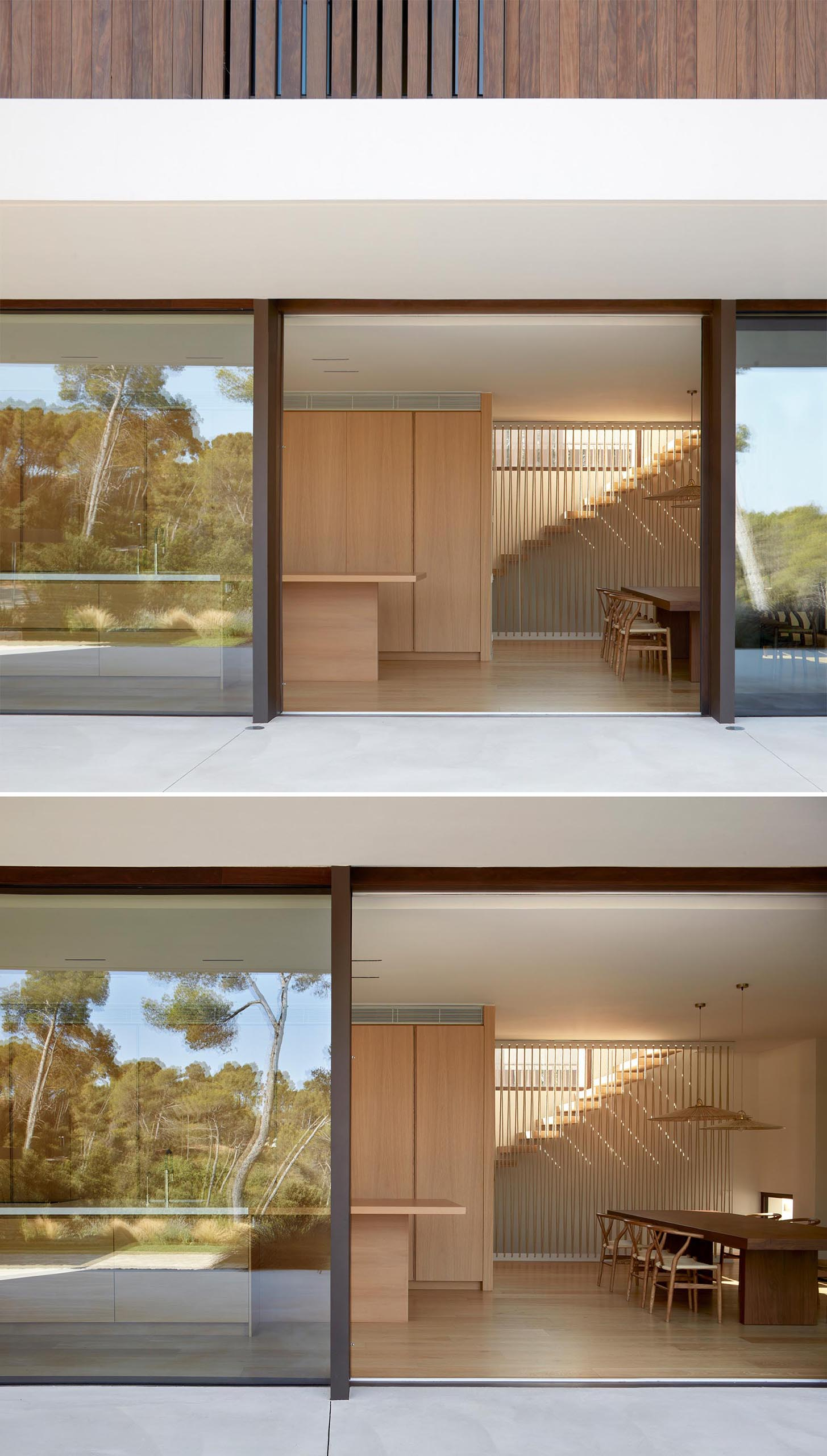 A modern house with a large sliding glass door that connects the interior and outdoor spaces.