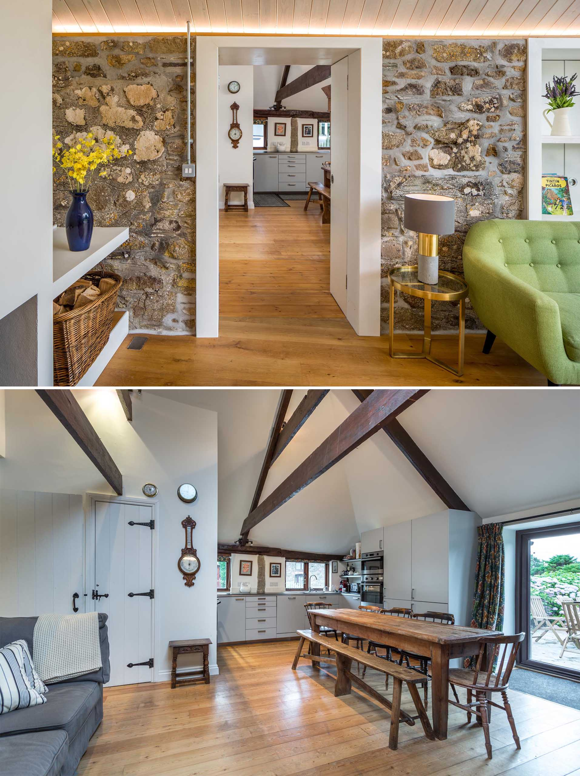 In this kitchen, accessed through an opening in a stone wall, dark wood beams draw the eye upwards to the high ceiling.