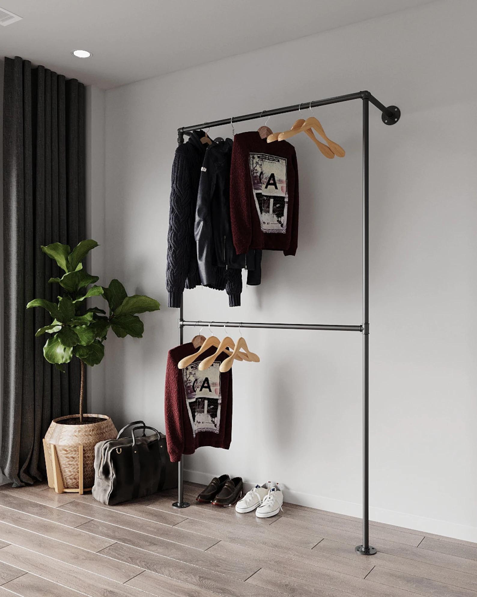 Storage Idea - Modern wall mounted black metal clothes rack.