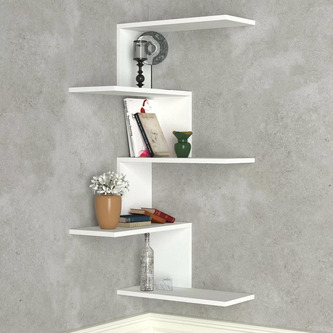 Corner Shelf Ideas - A modern white corner shelf with multiple levels.