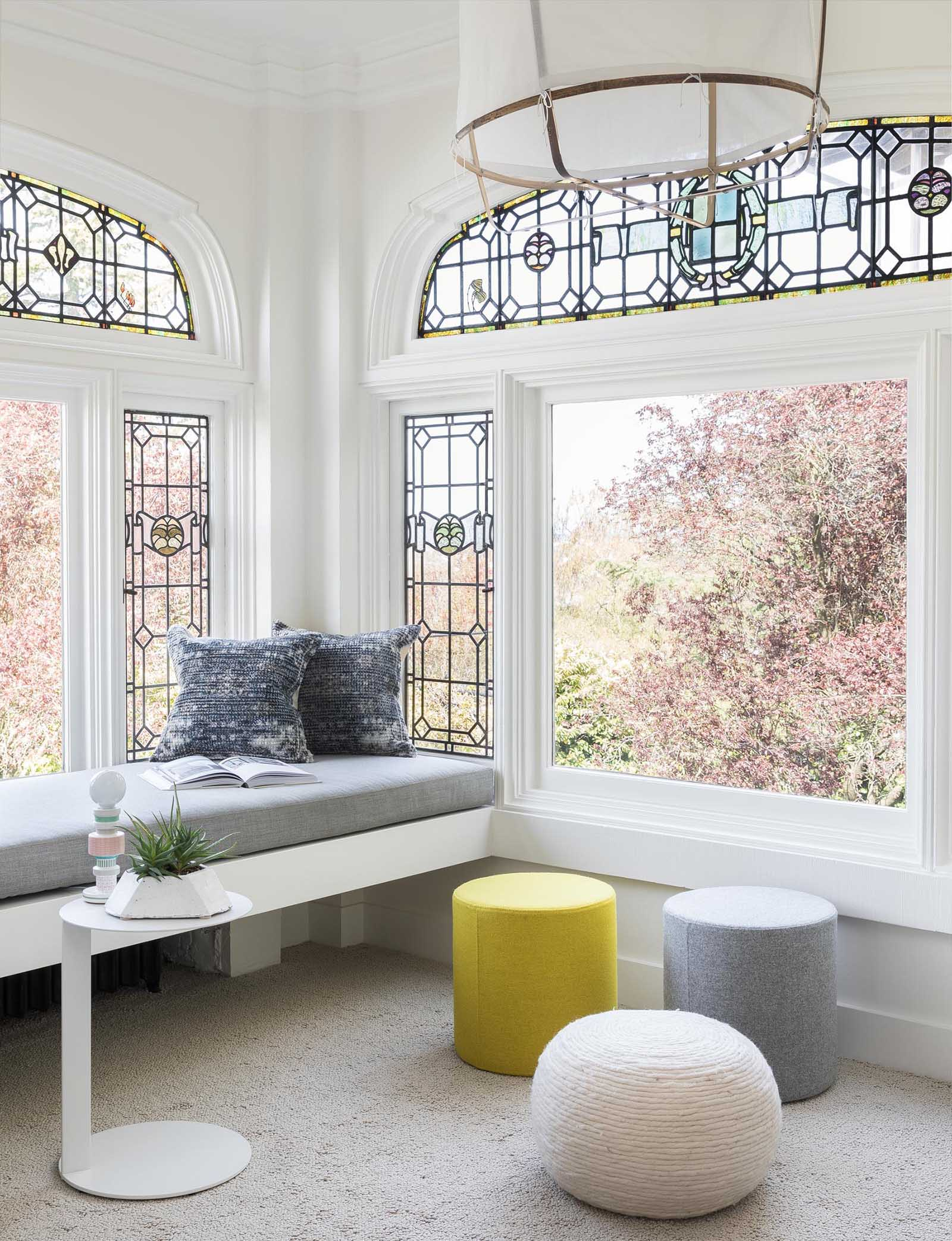A built-in window bench adds seating and takes advantage of the garden views.