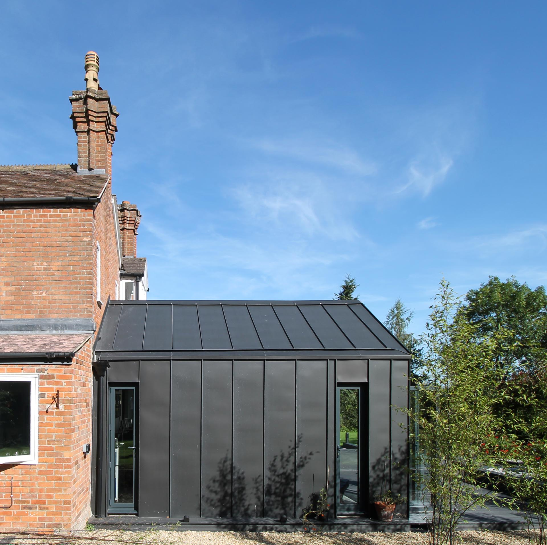 A modern extension with black zinc cladding.