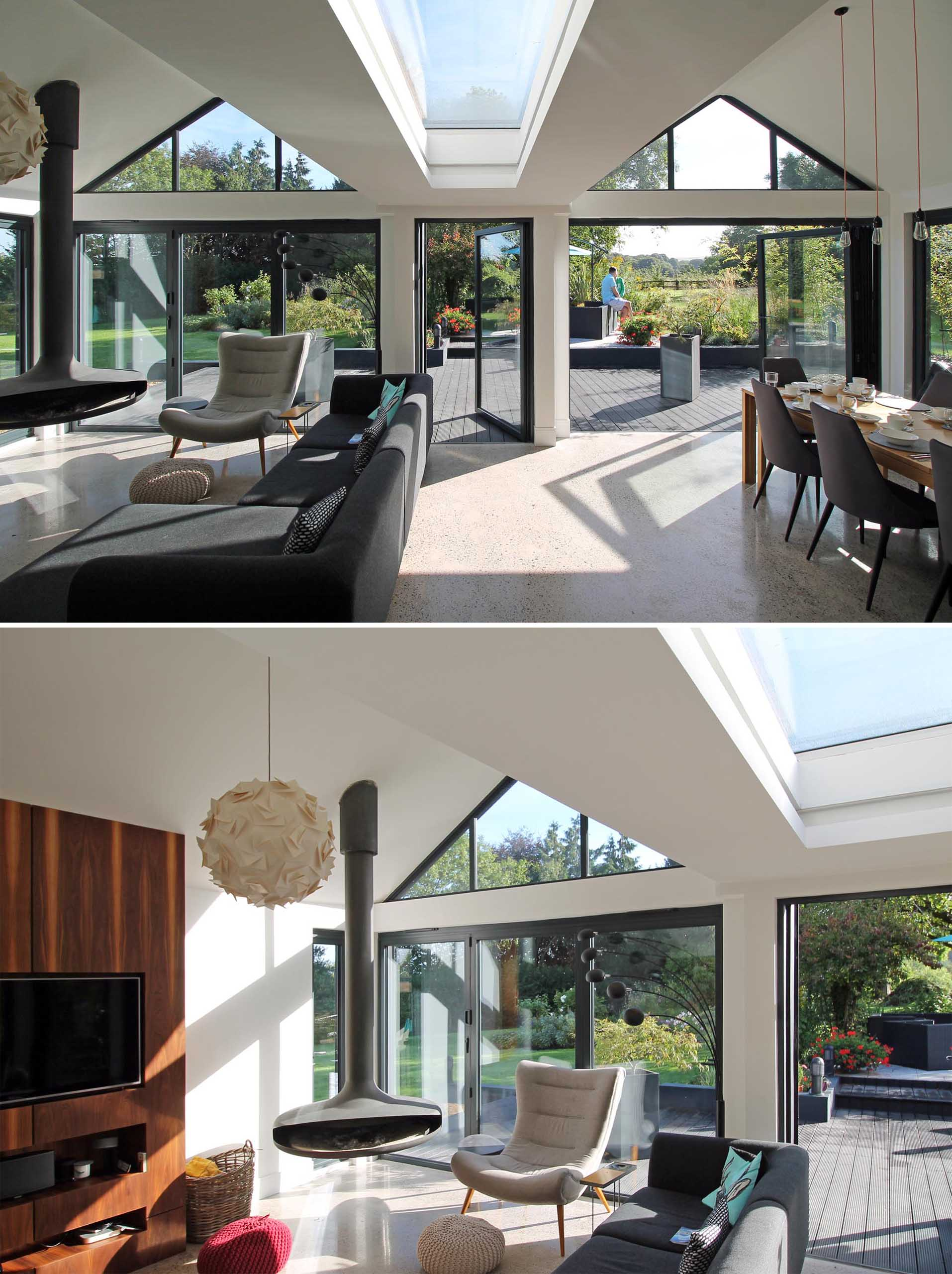 Inside this modern extension, the pitched roofs are open and each roof defines a zone in the open plan space below, like the living room and dining area.