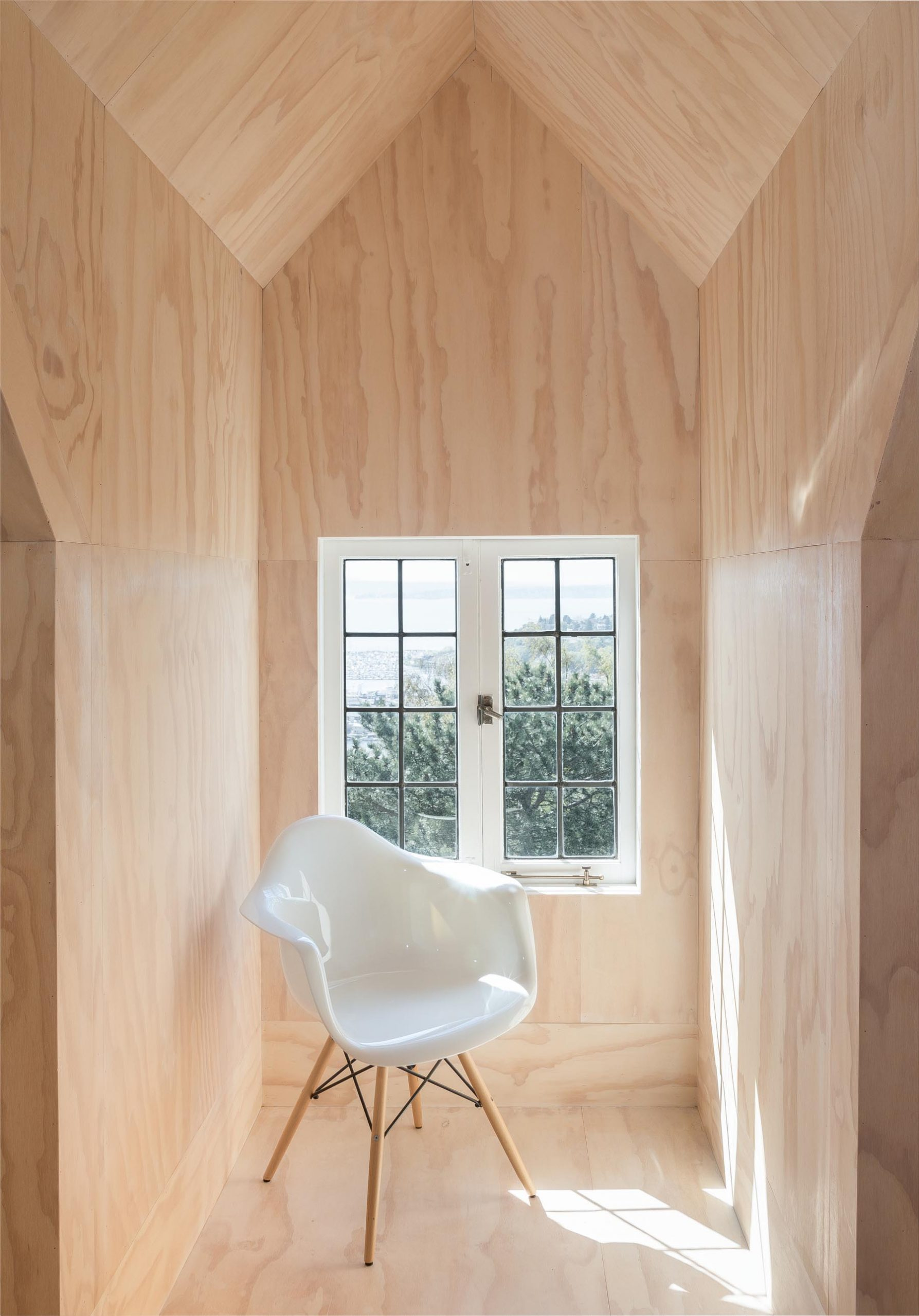 A plywood lined seating alcove.